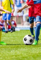 depositphotos_122899466_stock_photo_youth_football_soccer_match_kids